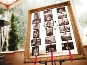 Wedding decorated in purple, pink and gold. table assignments in a picture frame display.