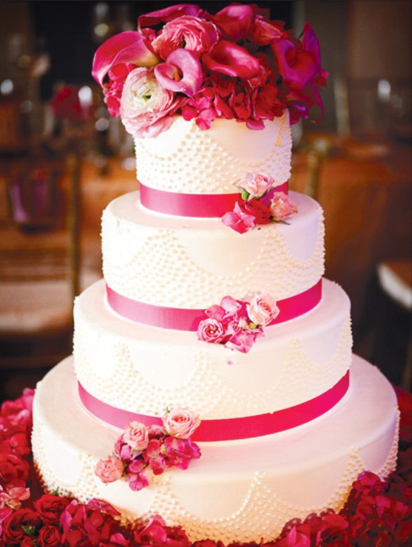 Wedding decorated in purple, pink and gold. Pink 3 tier wedding cake