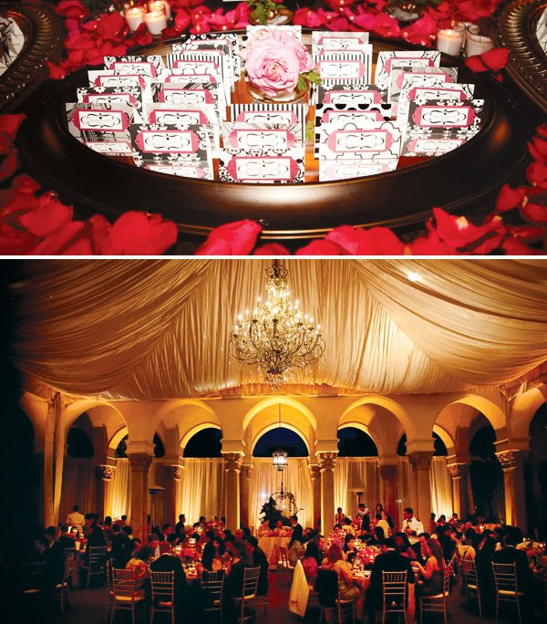 Wedding decorated in purple, pink and gold. Room arrangement and red rose petals