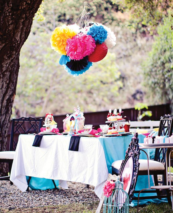 Alice in Wonderland Wedding tablescape, dress, and place settings