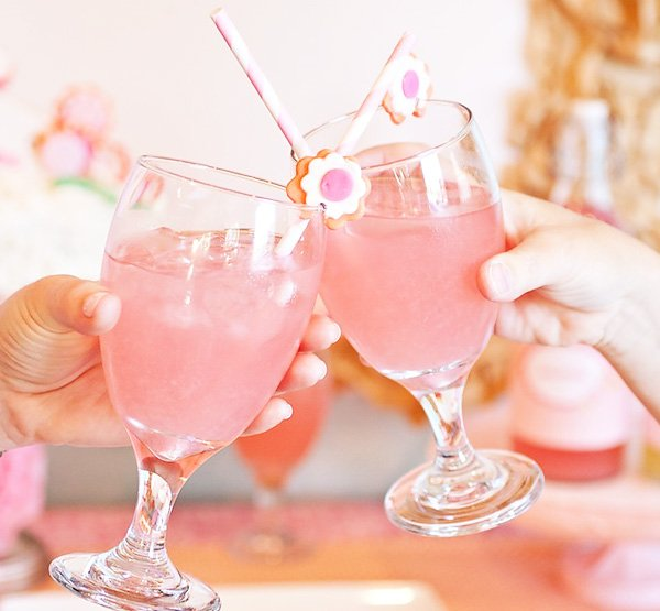 Pink drinks with flower straws