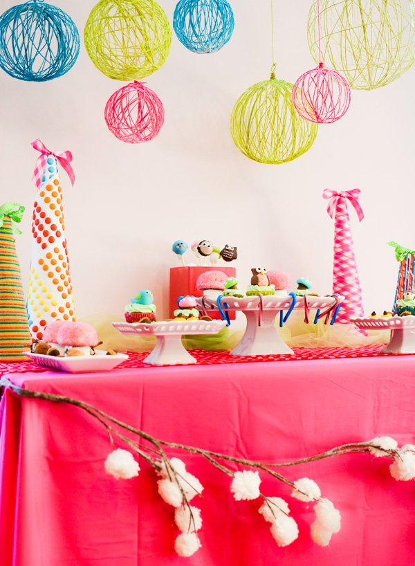 whimsical wonderland dessert table with forest creatures