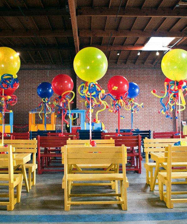 coles party train red, yellow and blue (primary colors) picnic style tables with balloons
