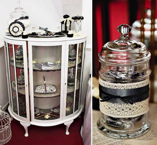 Apothecar jars decorated with black satin ribbon and lace