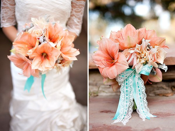 Coral orange bridal bouquet with aqua ribbon and lace
