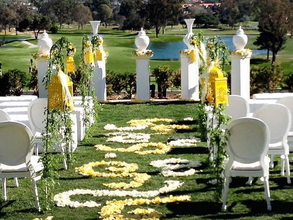 Modern Outdoor Yellow and White Wedding Ceremony with flower petal aisles