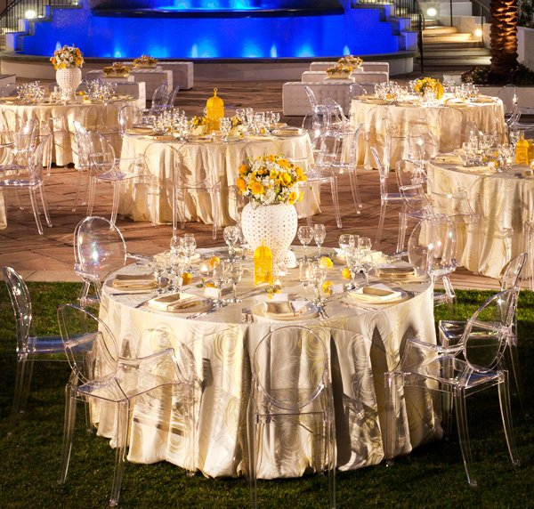 Modern Yellow and White Wedding Reception with Ghost Chairs