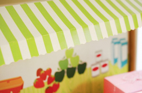 grocery store party green and white striped awning
