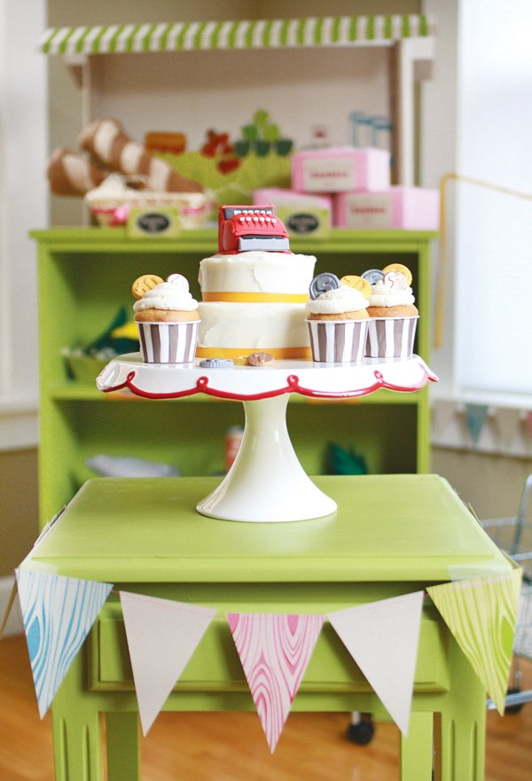 grocery store party cake with a cash register on it and cupcakes with coins