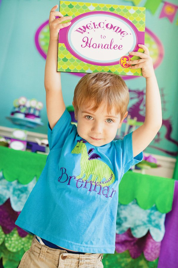 puff the magic dragon birthday party Brennan wearing dragon t-shirt and holding sign