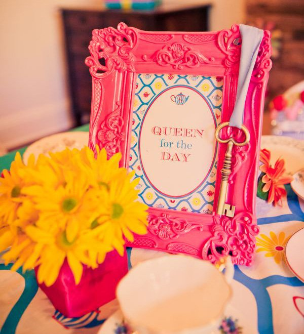 alice in wonderland birthday party with queen for a day sign, key and yellow flowers