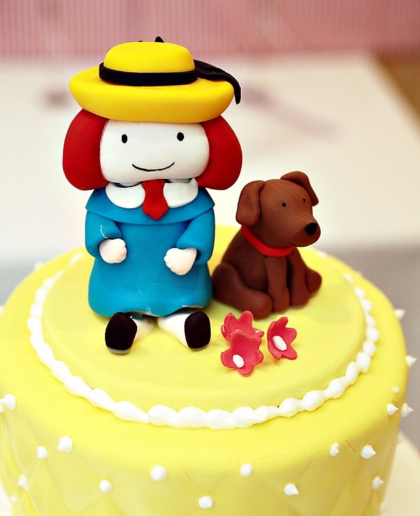Madeline themed cake with fondant madeline cake topper