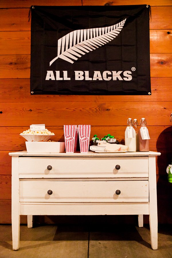 rugby first birthday party all blacks poster and snack bar