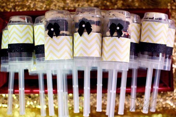 yellow chevron and black bow tie decorated pushcakes for a star is born operation shower