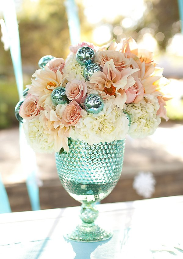 coral pink and aqua winter flower centerpiece