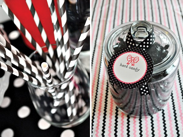 black and white stripey straws and black candies in a jar
