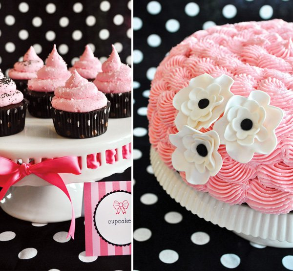 pink ruffle cake with white fondant flowers and pink frosted cupcakes