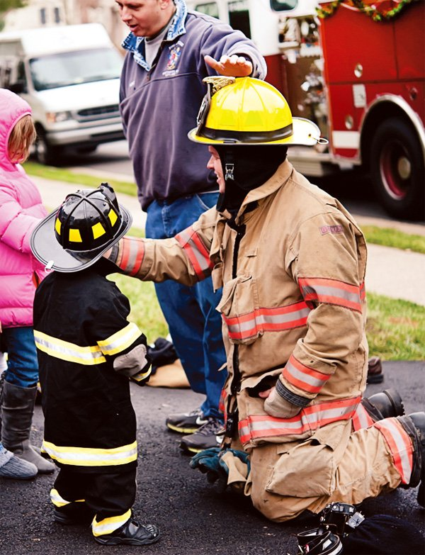 fire truck birthday party activity to meet the firemen and dress up in a firefighter outfit