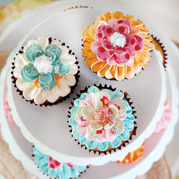 colorful flower cupcakes with flower cupcake toppers