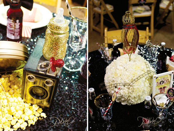 hollywood baby shower centerpieces with white carnation ball, glittered bottles, and popcorn