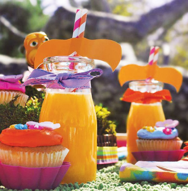 lorax party drinks - orange juice with mustache straws