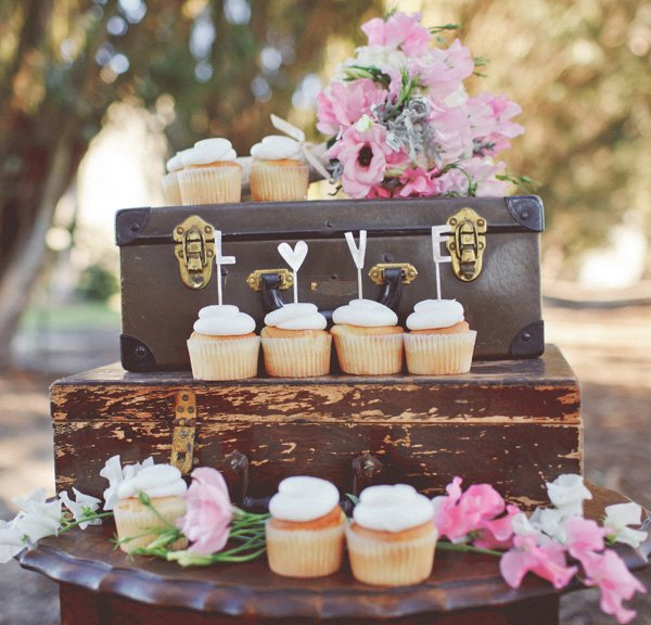 handmade love cupcake toppers on vintage suitcases