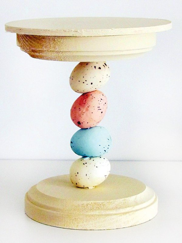 mini easter dessert stand with eggs in pink white and blue