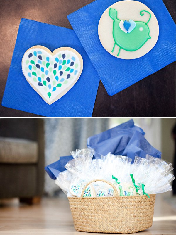 peacock baby shower cookies inspired by the invitation using green and blue