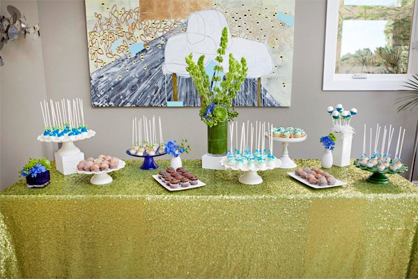 peacock baby shower inspired dessert table from a color palette of green and blue
