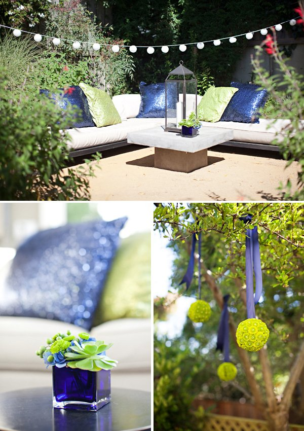 peacock baby shower inspired by the invitation using green and blue lounging area linens and flowers on tables and hanging flower balls from the trees