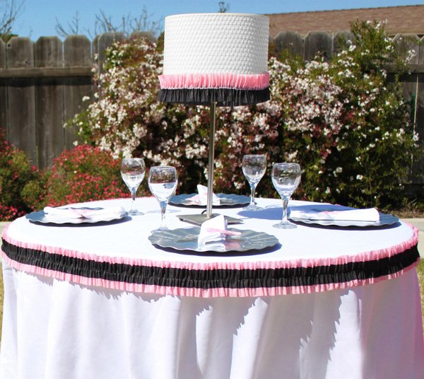 pink and black ruffle party streamers table