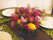 pink and purple spring flower centerpiece with lemons