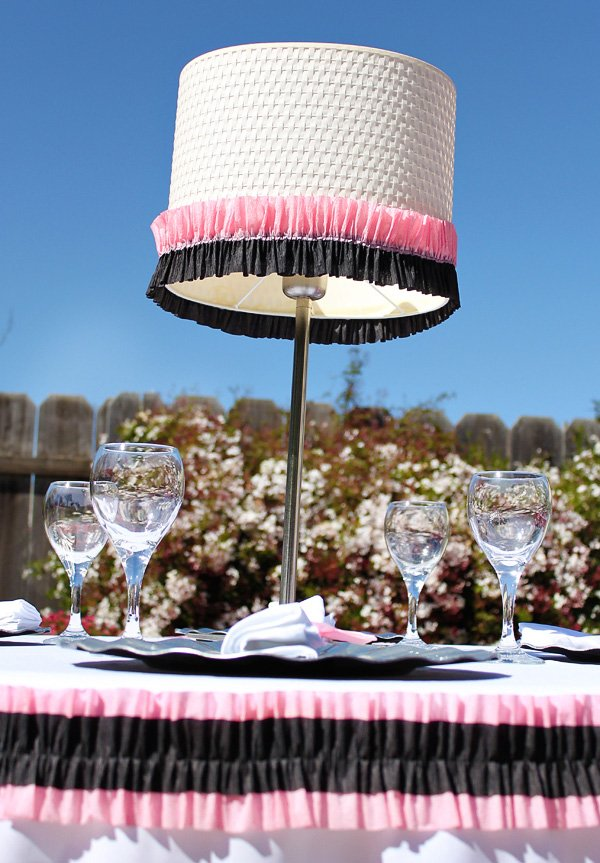 pink and black crepe paper ruffles table