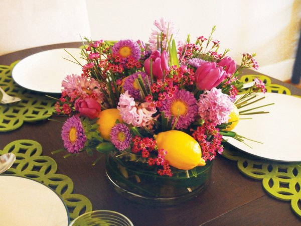 pink and purple floral centerpiece with lemons