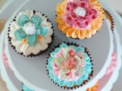 Cupcakes topped with handmade paper flower cupcake toppers