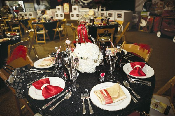 a star is born hollywood baby shower centerpiece and red & gold place settings