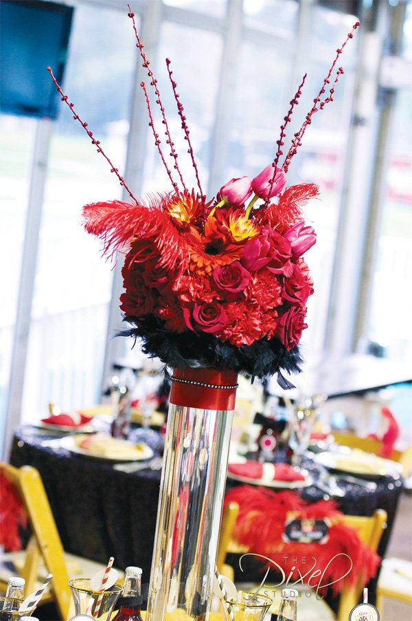 tall red flower and feather centerpieces - hollywood glam theme