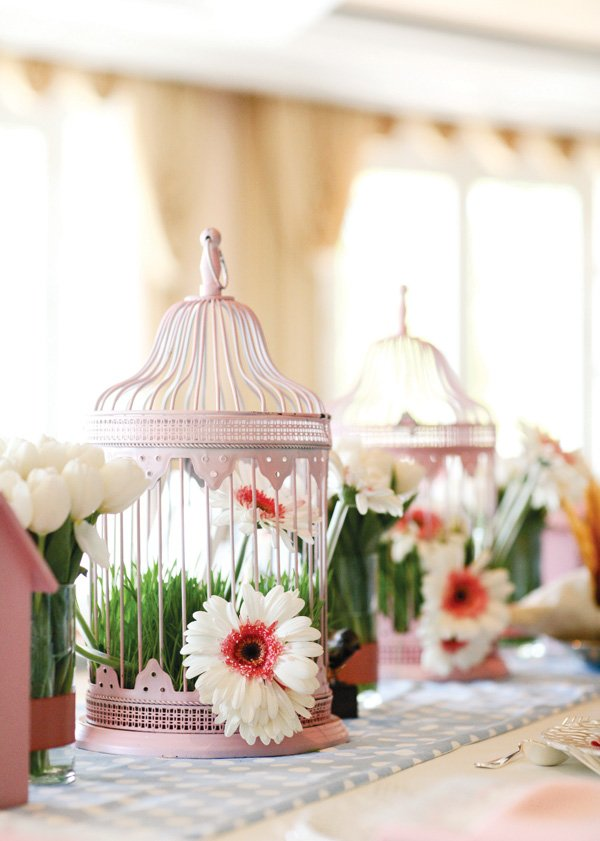 bird cage centerpiece with pink and white daisies