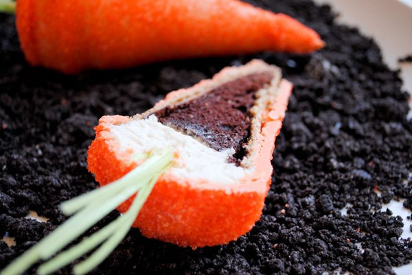 carrot shaped cupcakes made with sugar cones and sparkles for easter with oreo dirt