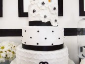 black and white coco chanel cake with quilting, polka dots and camila flowers