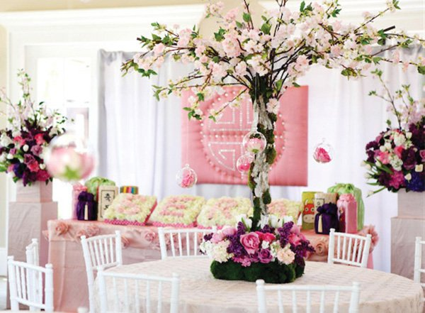 pink purple and white centerpiece with cherry blossoms and hanging glass balls