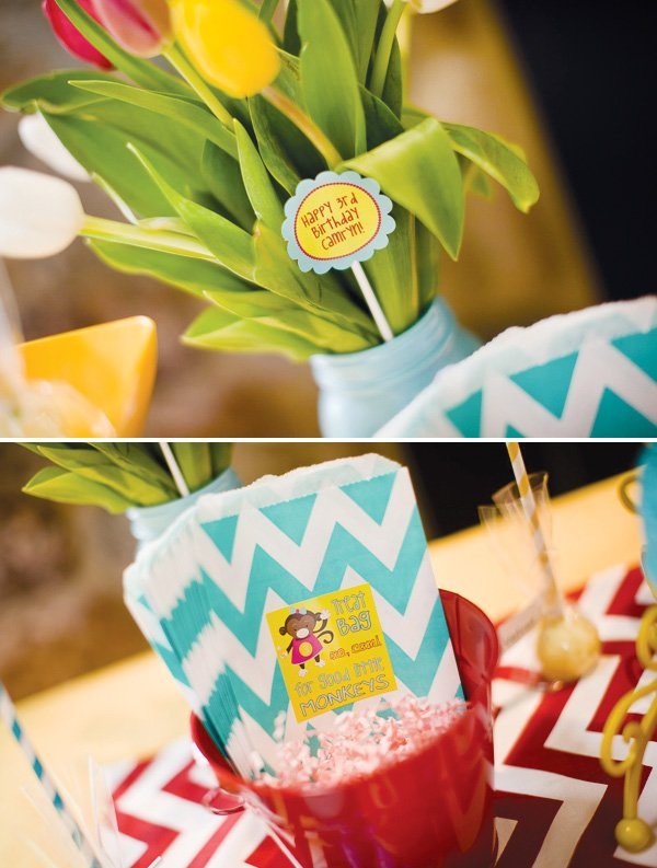 curious George theme party with chevron goody bags