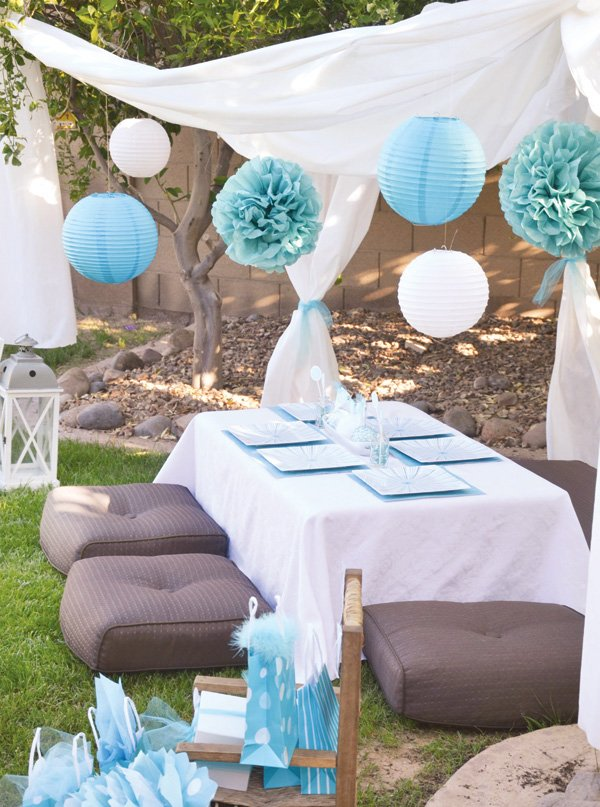 aqua dandelion birthday party in a backyard tent