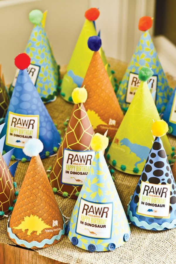 dino party hats with pom poms, zig zag ribbon and buttons