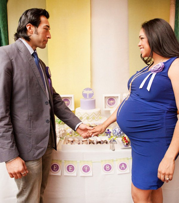 baby shower with couple at the dessert table