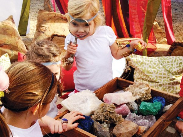 kids looking at precious stones at an egyptian themed birthday party