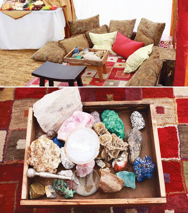 precious rock table in an egyptian themed party tent