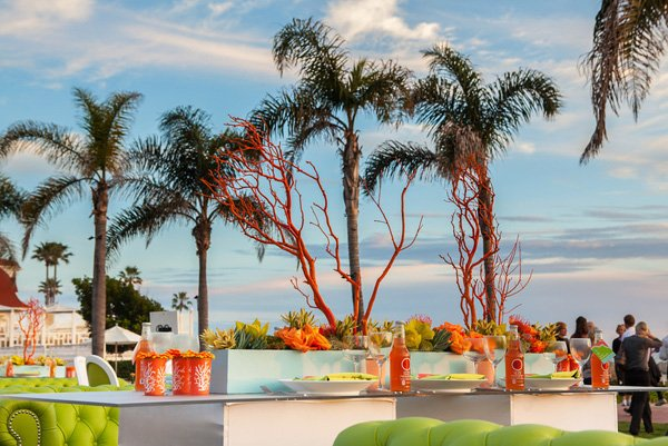mod beach wedding sunset and orange manzanita centerpieces