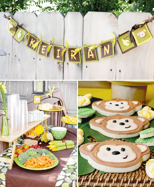 monkey birthday party food table and cookies displayed under a custom bunting