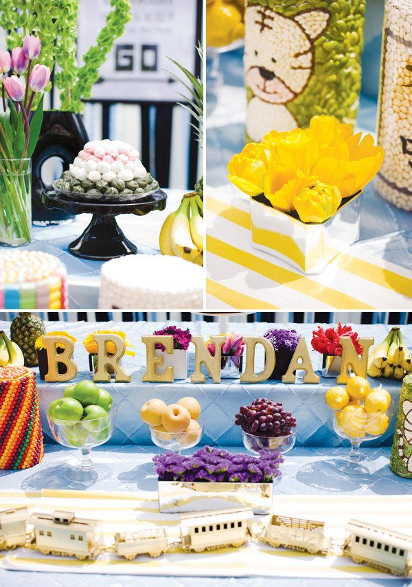 monopoly birthday party food table with yellow flowers and traditional korean food